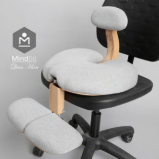 The image shows MindSit, a personalised seat that rests on an existing office chair and aims to the improve posture and mental health of the user.
