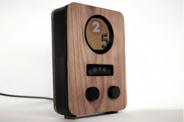 The image shows a Padio, a cuboid, wooden interface for tablet computers.