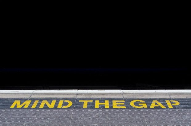 "Image of London tube platform with the words, ""mind the gap""."