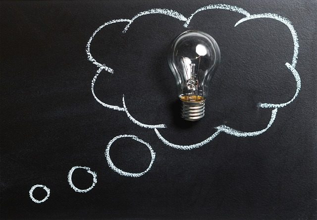 lightbulb surrounded by a thought bubble on a chalk board
